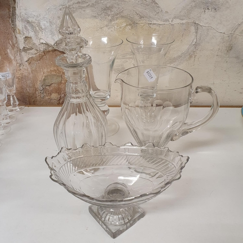 524 - A 19th century cut glass jug, 26 cm high, a set of four Waterford cut glass tumblers, a blue and whi...