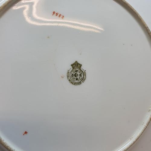 525 - A Royal Worcester dessert service, having five tazzi and nine plates, 23 cm diameter (14)