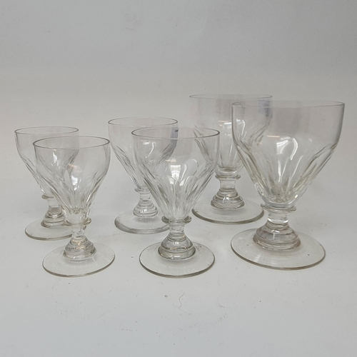 526 - A part suite of 19th century facet cut drinking glasses, comprising six red wine glasses, six white ...