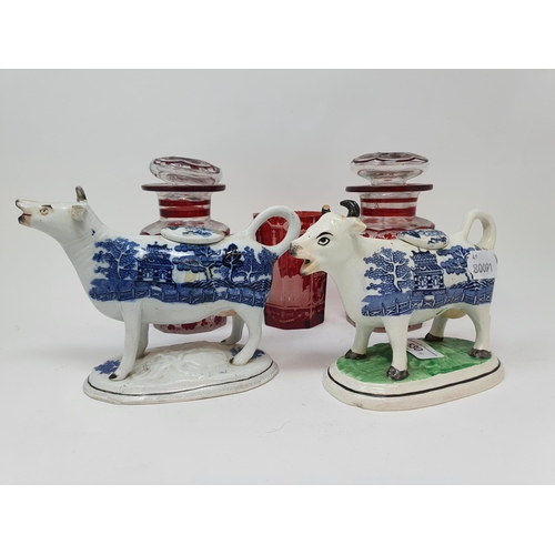 530 - A Staffordshire blue and white cow creamer, 17 cm wide, another, and three items of glass (5)