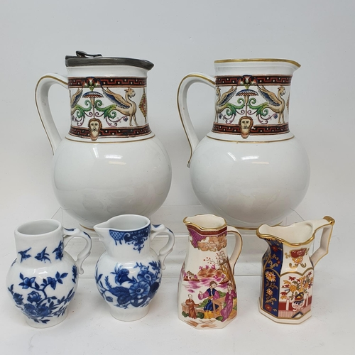 556 - A pair of jugs, decorated phoenix, other ceramics and glass (4 boxes)