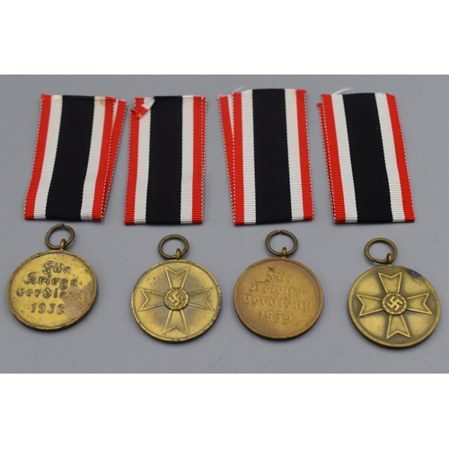 14 - Four Third Reich War Merit Medals with Ribbons...