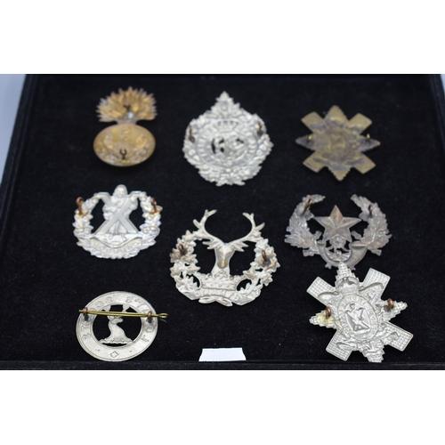 42 - Eight Scottish Glengarry Badges including Lovat Scouts, Gordon Islanders, Argyll & Sutherland Highla...
