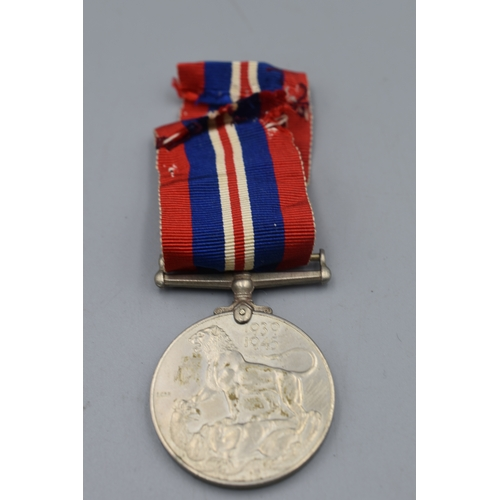 95 - WWII British War Medal. Full Sized with Ribbon...