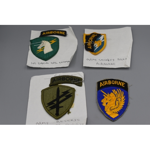 217 - Four US Airborne embroidered Uniform Badges...