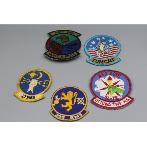 219 - Five US Airforce Squadron Badges...