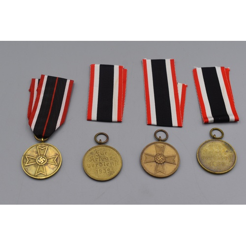 47 - Four Third Reich War merit Medals with Ribbons...
