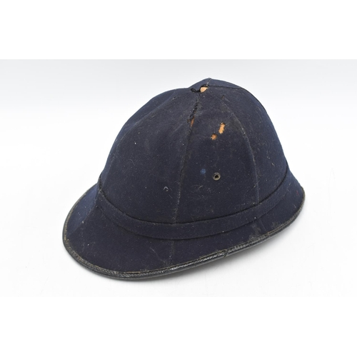 20 - Early 20th Century Cork Bodied Police Helmet by Christy's London. Damaged....