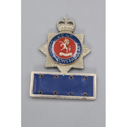 27 - Kent Constabulary Helmet Plate plus a Kent Name Badge...