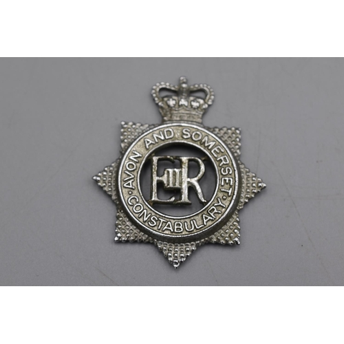 30 - Avon & Somerset Helmet Plate plus a Cap Badge...