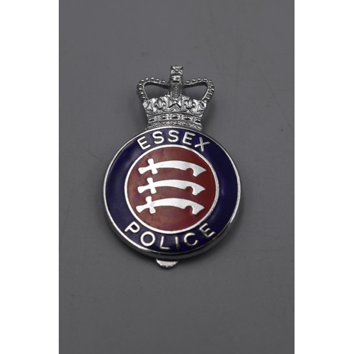 34 - Essex Police Helmet plate plus Cap Badge...