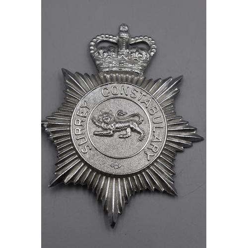 38 - Two Police Helmet Plates, Surrey & Suffolk...