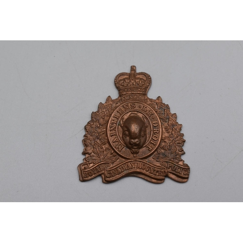 48 - Royal Canadian Mounted Police Copper Cap Badge...