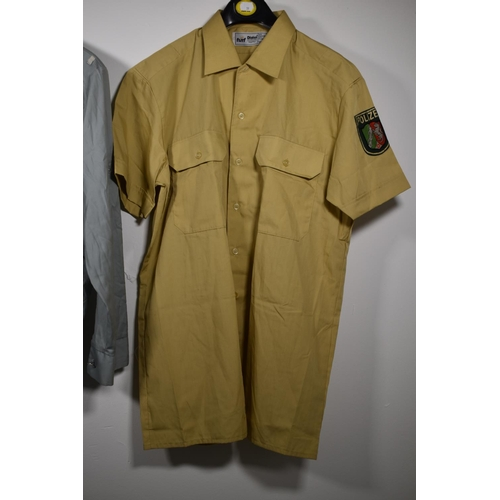 59 - German Police Shirt with Badge and Blue Two Pocket Button Fronted Jacket...
