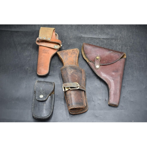 1 - Three Different Leather Pistol Holsters Plus a Leather Belt Pouch...