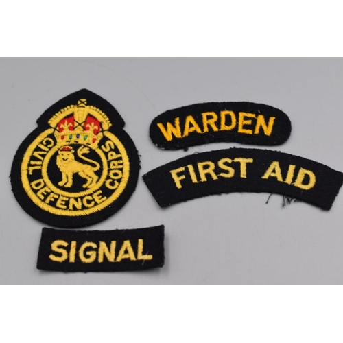 11 - Four Civil Defence Embroidered Badges...