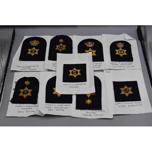 12 - Nine Vintage Royal Navy Gold Bullion Badges...