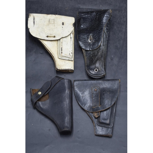 2 - Four Leather Pistol Holsters...
