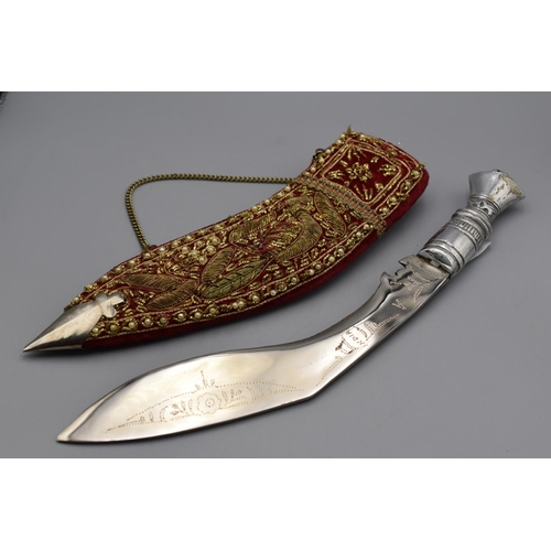 Kukri Knife with a metal grip and a gold bullion decorated velvet covered scabbard. 31cm long