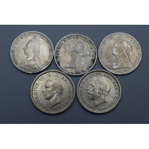 30 - Three Victorian, One George V and One George VI Silver 3 Penny Coins (1897, 1931,1889, 1940 and 1873...