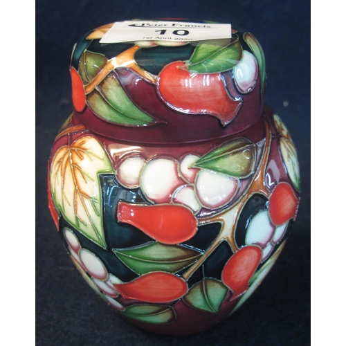 10 - Modern Moorcroft art pottery tube lined ginger jar and cover of baluster form, overall decorated wit...
