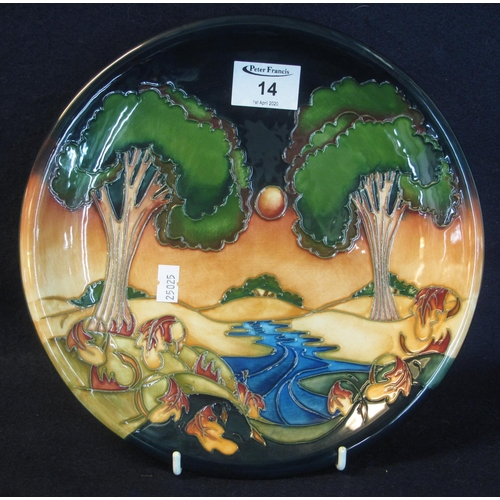 14 - Modern Moorcroft art pottery tube lined cabinet plate or charger, overall depicting a forest and str...