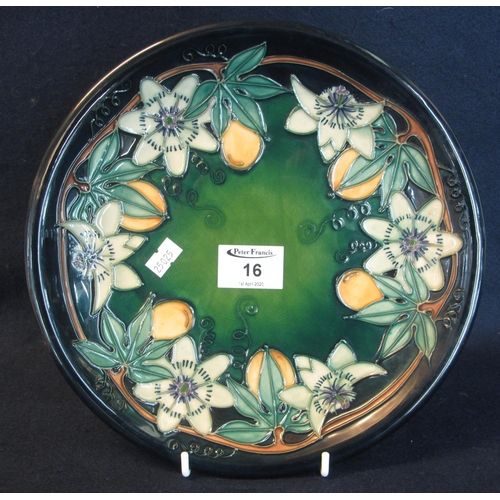 16 - Modern Moorcroft art pottery tube lined cabinet plate or charger, overall on a green ground depictin...