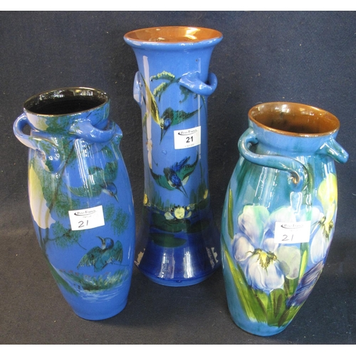 21 - Three Torquay pottery Lemon and Crute vases, one of tapering form decorated with flowers, birds and ...