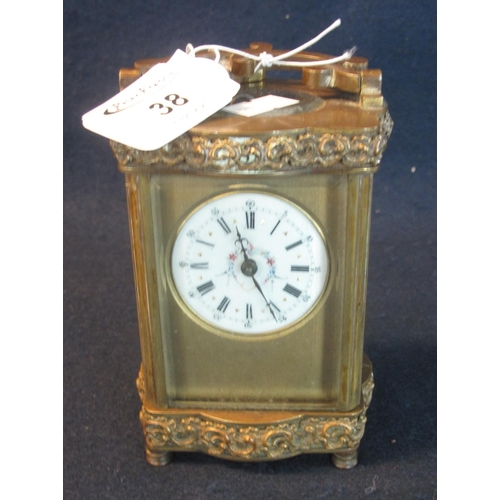 38 - 20th Century French brass carriage clock with circular enamel dial, having Roman numerals. the case ...