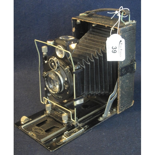 39 - A Compur folding reprographic plate camera with leather case and wallet of dark slides. (3) (B.P. 24...