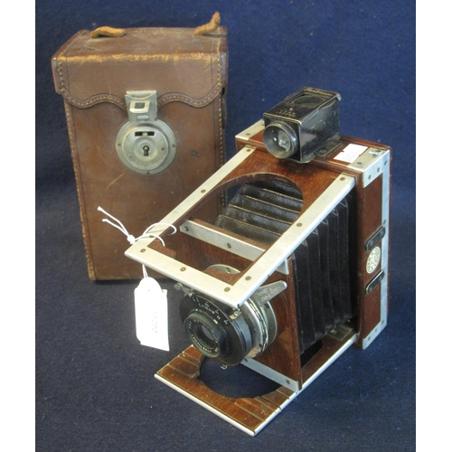 42 - A Shew XIT patent mahogany folding plate camera with Lukos II lens and original leather carrying cas...