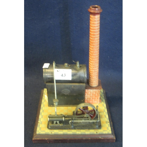 43 - A Bing German brass and tinplate stationary engine on square base.  (B.P. 24% incl. VAT)...