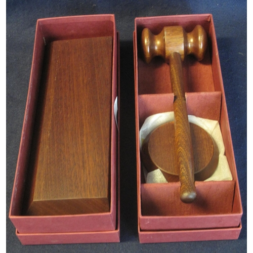 44 - Modern mahogany gavel with small block, together with matching rectangular block, in original boxes....