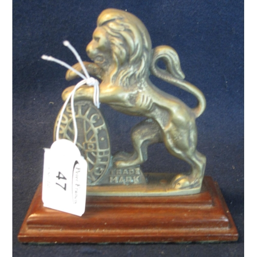 47 - A Justice and Strength brass lion passant mascot, probably from a set of scales originally, now on s...