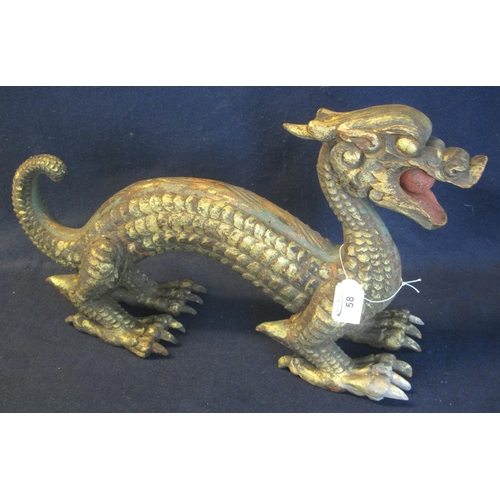 58 - Large carved and gilded wooden dragon, his mouth holding a pearl.  (B.P. 24% incl. VAT)...