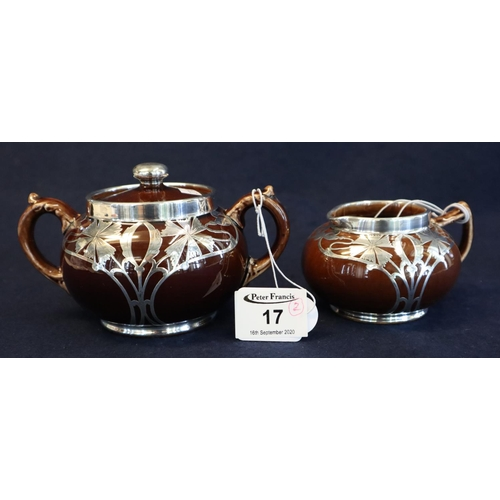 17 - George Jones sterling silver overlaid brown ground pottery sucrier and cream jug. (2) (B.P. 21% + VA...