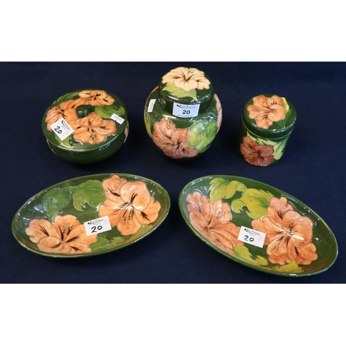 20 - Five matching Moorcroft pottery tube lined items, all on a green ground with pink flowers, impressed...