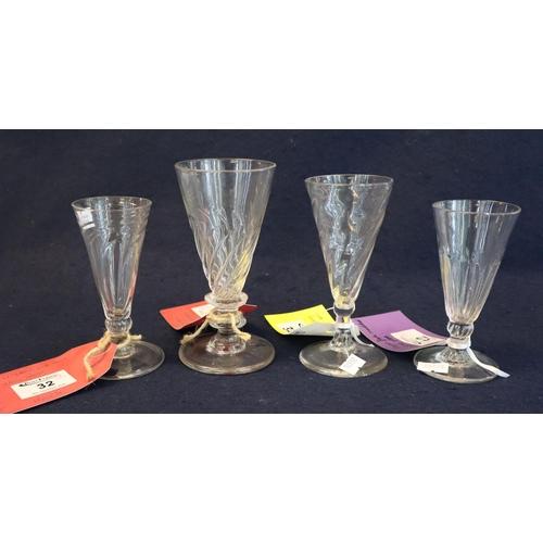 32 - Four similar Georgian wrythen stem and ale glasses, all on circular bases. (4) (B.P. 21% + VAT)...