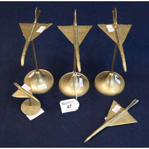 47 - Four brass studies of Concorde on stands, together with another without a stand. (5) (B.P. 21% + VAT...