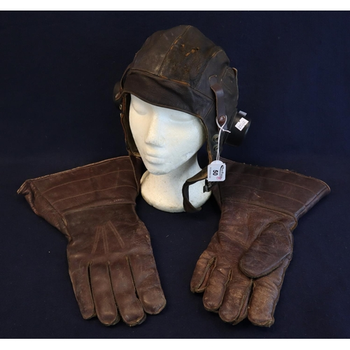 50 - Early 20th Century British aviator's leather helmet marked A.M size 2, together with a pair of leath...