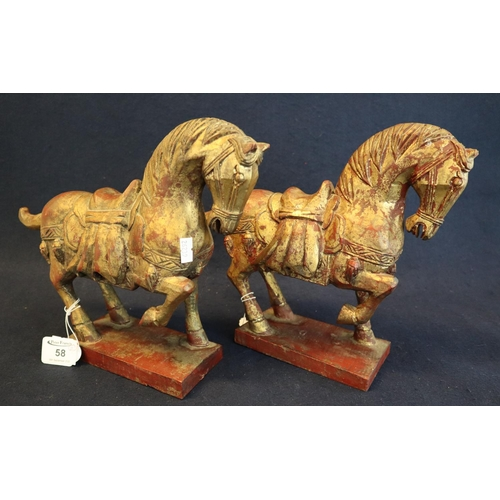 58 - A decorative pair of Tang style carved wooden horses on rectangular bases. (B.P. 21% + VAT)...