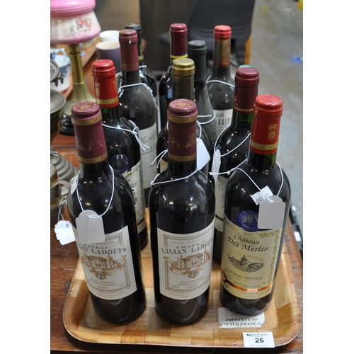 26 - 12 bottles of assorted red wine to include; Roe Flamboyant Fitou 2005, Chateau Lilian Ladouys 2002 (...