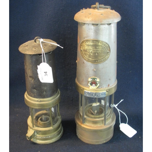 34 - Two brass miner's safety lamps, including a smaller one in used condition and an E Thomas & Williams...