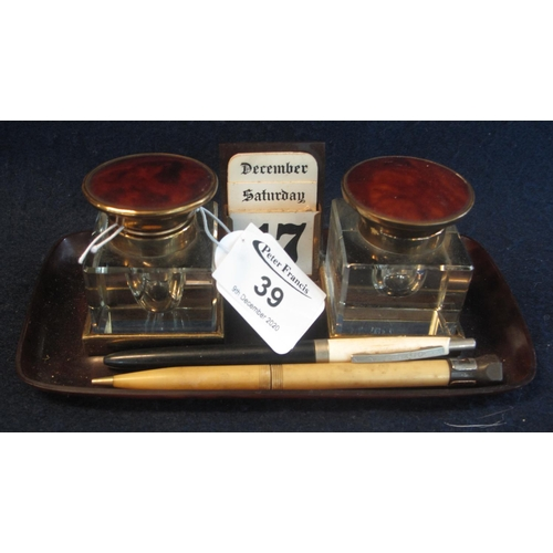 39 - A simulated tortoiseshell brass mounted double inkwell desk stand with central calendar and vintage ...