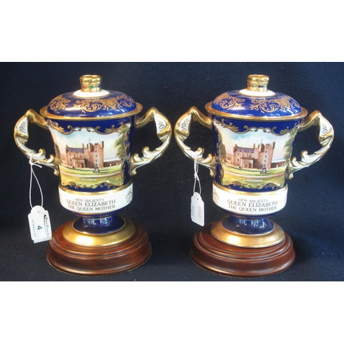 4 - Two Aynsley bone china hand painted lidded two handled commemorative vases for Her Majesty Queen Eli...