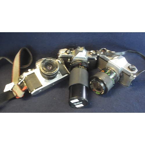 47 - Three Pentax 35mm SLR camera bodies including an ME, together with Pentacon 3.5/30 lens, a Centon 28...