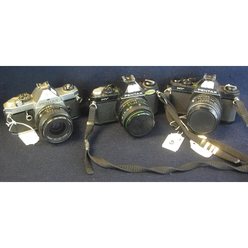 49 - Three Pentax 35mm SLR cameras, MX and two MV models, with Pentax 50mm and 28mm lenses and a Hanimex ...