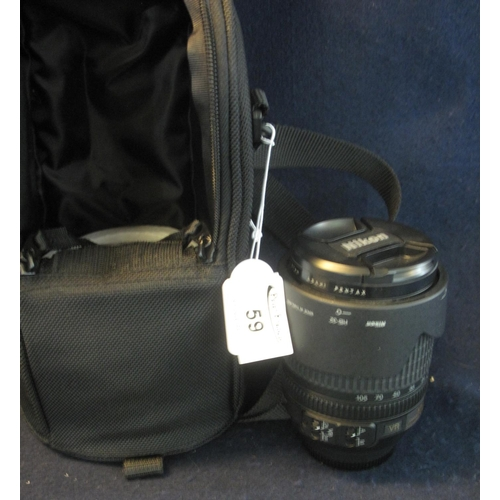 59 - Nikon 18-105mm DX zoom lens in fabric case, with lens cap. (B.P. 21% + VAT)...