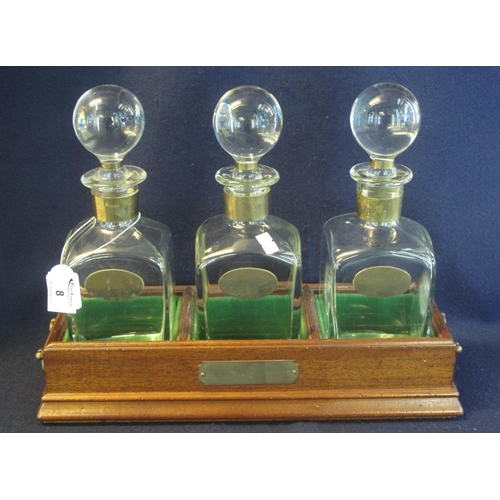 8 - Modern open tantalus or decanter stand with three square section decanters having globular stoppers ...