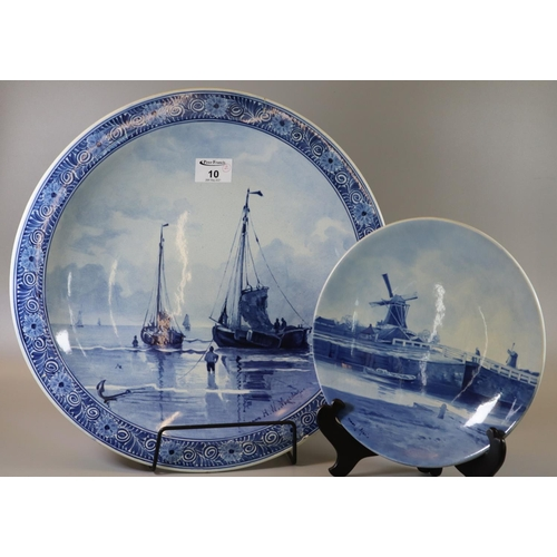 10 - Joost Thooft & Labouchere delft blue and white charger or shallow bowl depicting sailing boats at se...
